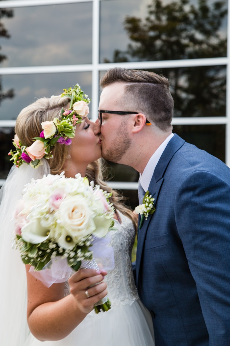 Littleton wedding photographer bride and groom floral crown in love