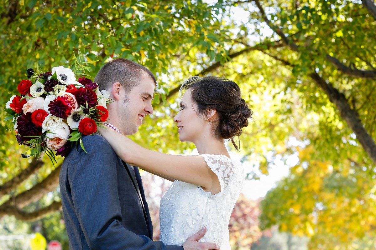 Littleton wedding photographer at St. Mary's Catholic church ceremony mass bride and groom in love fall leaves