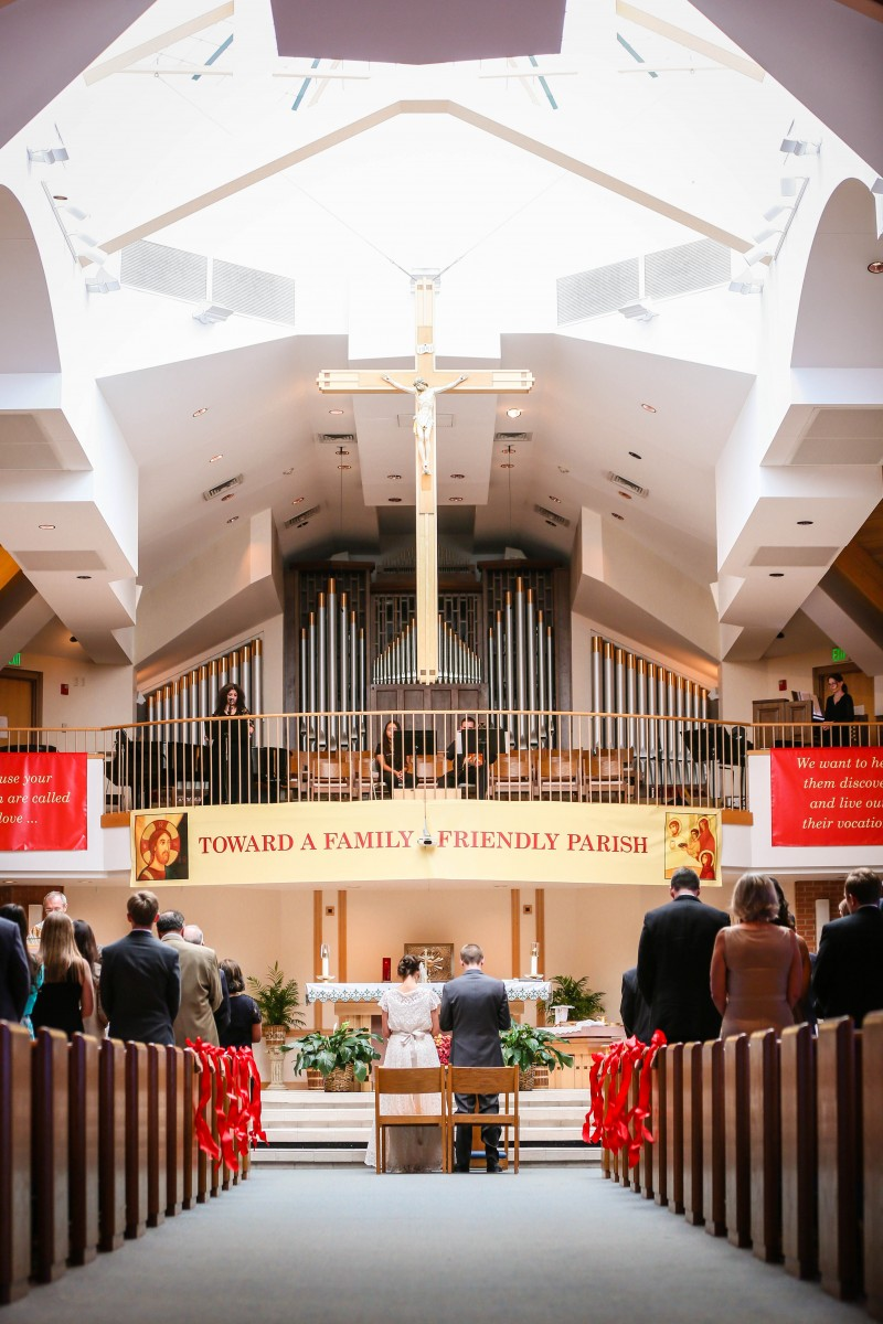Littleton wedding photographer in Colorado Catholic church ceremony mass bride and groom