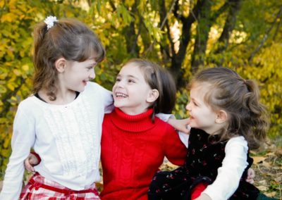 Littleton child photographer family sisters laughter real smiles love in Colorado