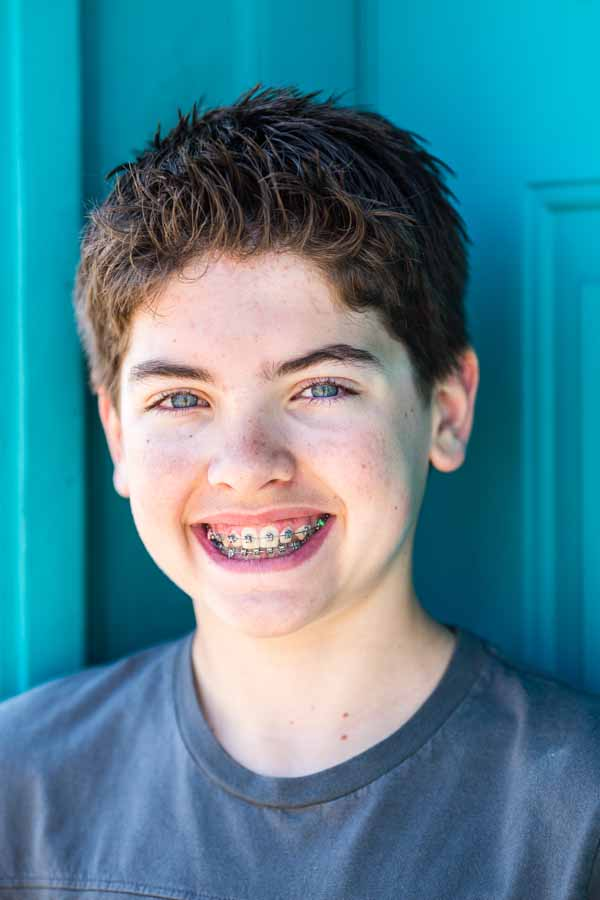 Littleton child and family photographer teen teenager boy braces urban session photography