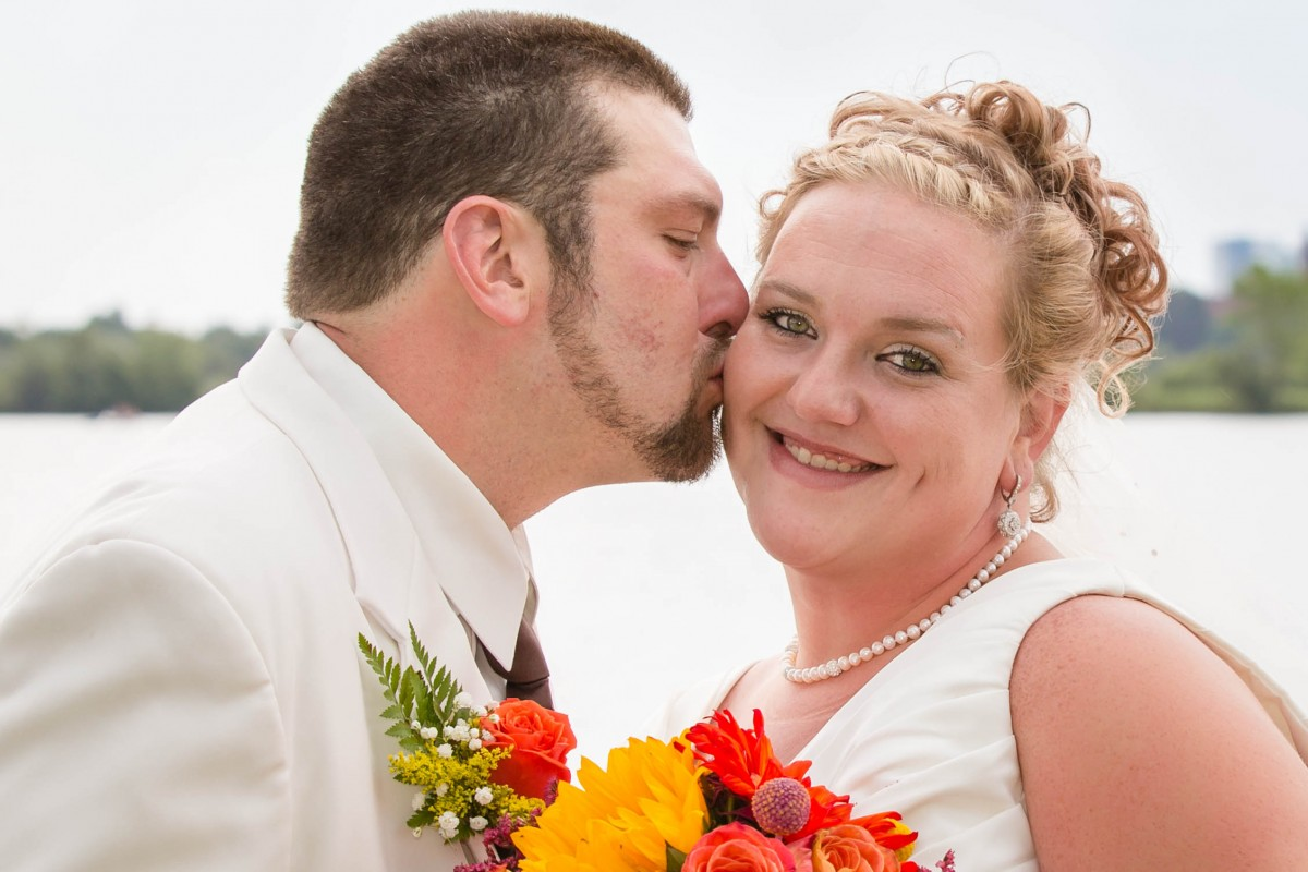 Littleton wedding photographer in Denver Colorado metro area bride and groom Sloan's Lake kiss in love marriage