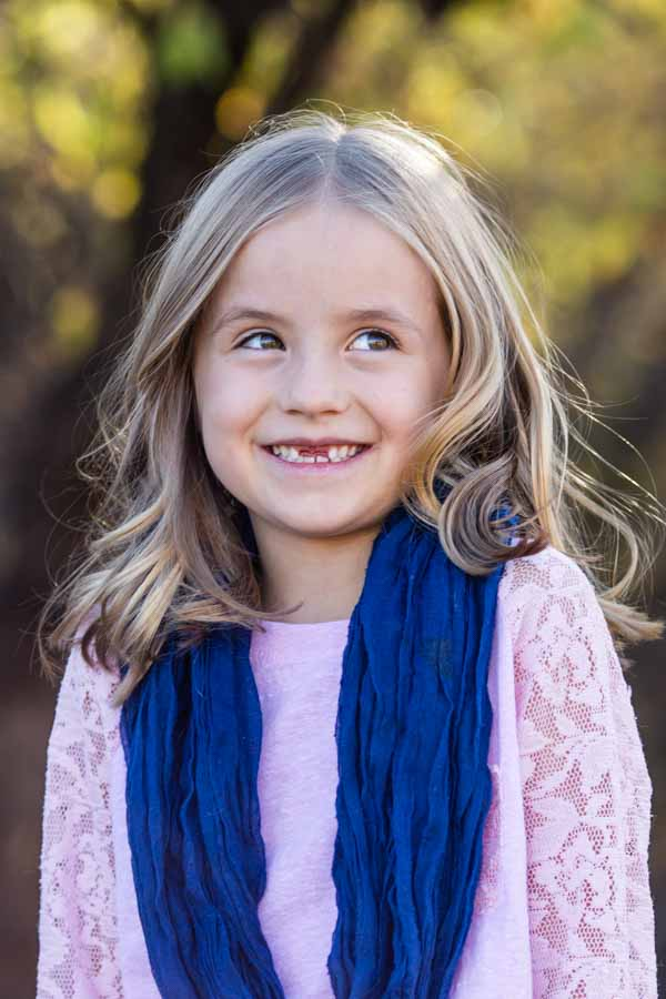 Littleton family and child photographer in Colorado cute girl with missing teeth