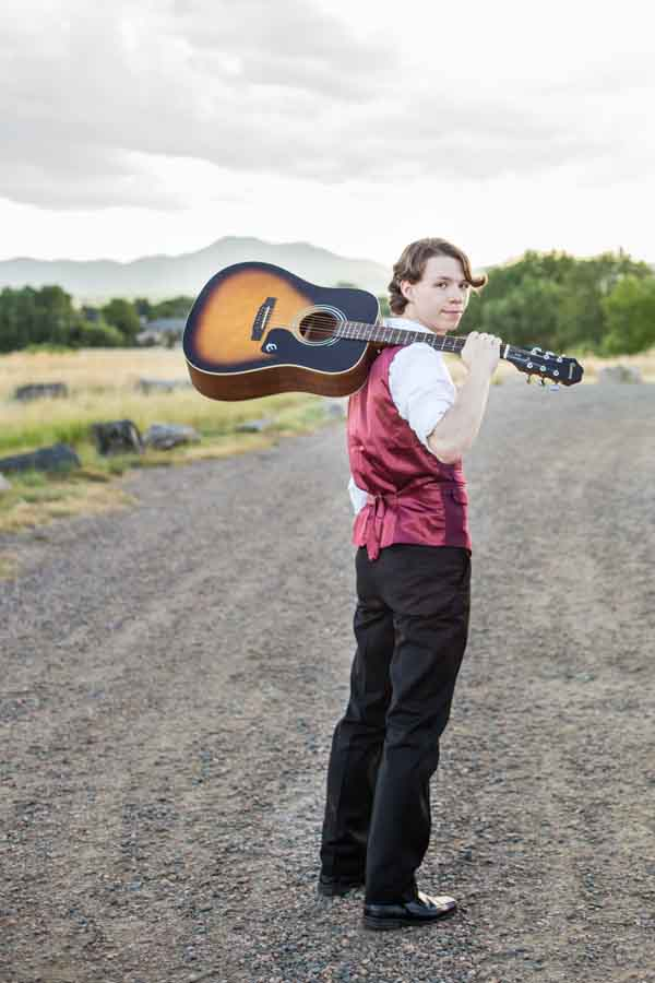 Littleton high school senior photographer in Colorado schools boy with a guitar