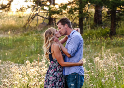 Littleton family photographer couple in love kissing