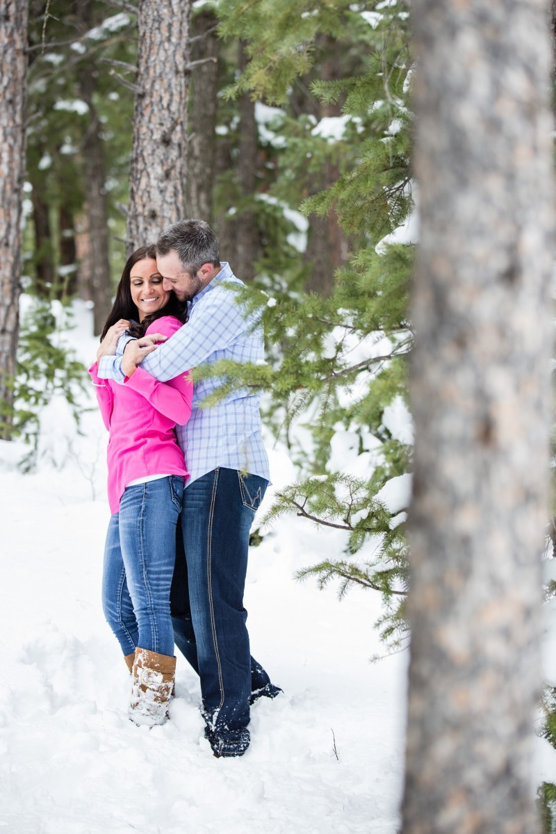 Littleton photographer snow engagement session in love engaged
