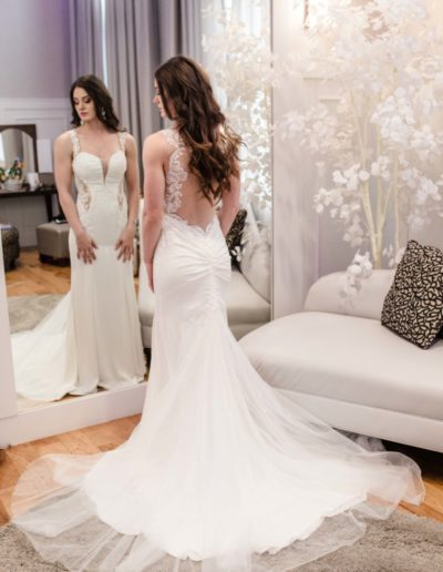 Littleton wedding photographer bride bridal portrait dress white train flowing The Falls Event Center Colorado photography