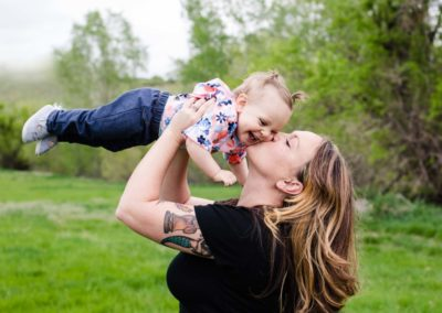 Littleton family photographer child baby mother daughter Hildebrand Ranch Colorado foothills spring photography Jefferson County fun laughter nature