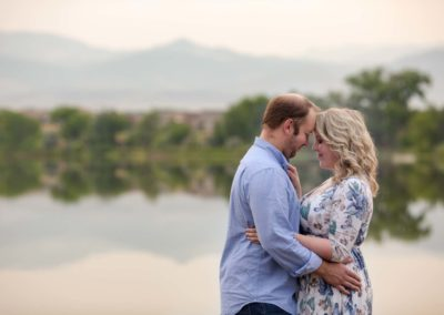 Littleton family photographer couples in love lake summer couple Colorado golden hour sunset forehead snuggles married marriage