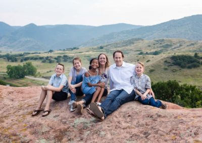 Littleton family photographer South Valley Open Space park Ken Caryl red rocks rock formations Colorado foothills photography mountain view adoption kids children boys girls