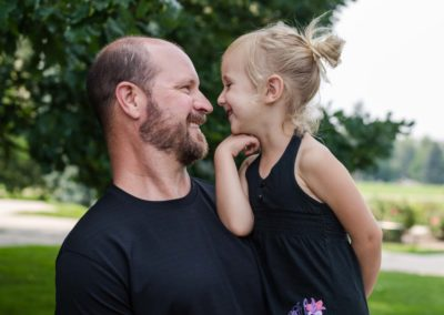 Littleton family photographer father daughter little girl noses nose Denver photography sweet