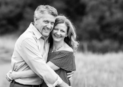 Littleton family photographer couple in love marriage married black and white snuggles