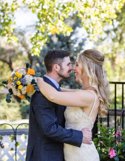 Littleton wedding photographer backyard Lakewood bride and groom in love nose to nose formal portraits husband wife ceremony vows