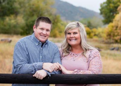 Littleton family photographer couples couple in love husband and wife fall in Colorado married marriage fence Hildebrand Ranch foothills photography
