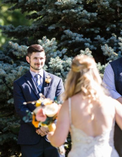Littleton wedding photographer backyard bride and groom in love walking down the aisle marriage married vows ceremony