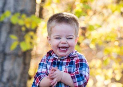 Littleton family photographer little boy toddler happy giggles unposed real outdoor photography Colorado fall yellow leaves trees
