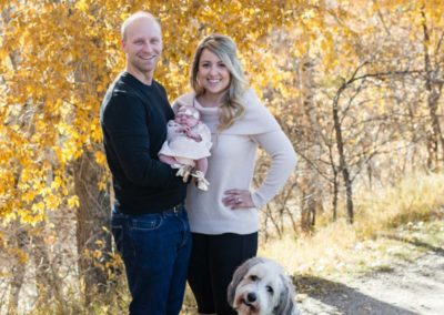 Littleton family photographer dog baby newborn parenthood parents fall in Colorado High Line trail Fly'N B park Highlands Ranch photography yellow leaves trees new