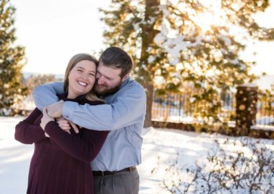 Littleton engagement photographer engaged couple in love Highlands Ranch Mansion Colorado foothills golden hour sunset light photography snuggle husband and wife to be snow winter esession