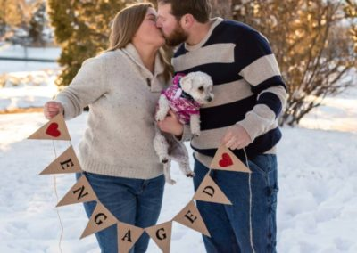 Littleton family photographer engaged couple session engagement esession Highlands Ranch Mansion snow winter in love dog diamond ring banner sunset golden hour light