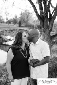 Littleton family photographer engagement session engaged wedding husband and wife to be Lakewood Country Club spring couple in love sunset green golf course bridge stone save the date announcement photography Colorado kiss kissing kisses black and white