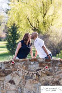 Littleton family photographer engagement session engaged wedding husband and wife to be Lakewood Country Club spring couple in love sunset green golf course bridge stone save the date announcement photography Colorado kiss kissing kisses golden light sunset banner