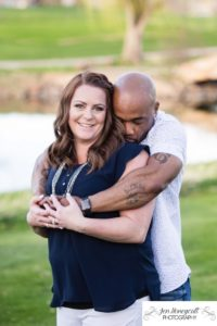 Littleton family photographer engagement session engaged wedding husband and wife to be Lakewood Country Club spring couple in love sunset green golf course kiss kissing kisses save the date announcement photography Colorado