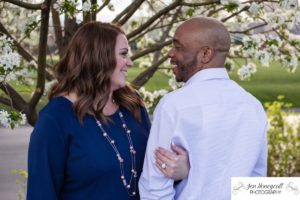 Littleton family photographer engagement session engaged wedding husband and wife to be Lakewood Country Club spring couple in love sunset green golf course save the date announcement photography Colorado white crabapple trees blooming