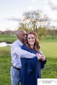 Littleton family photographer engagement session engaged wedding husband and wife to be Lakewood Country Club spring couple in love sunset green golf course bridge stone save the date announcement photography Colorado kiss kisses kissing fun