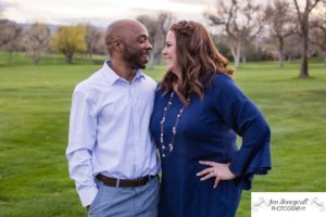 Littleton family photographer engagement session engaged wedding husband and wife to be Lakewood Country Club spring couple in love sunset green golf course bridge stone save the date announcement photography Colorado laughter laughing fun