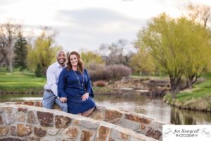 Littleton family photographer engagement session engaged wedding husband and wife to be Lakewood Country Club spring couple in love sunset green golf course bridge stone save the date announcement photography Colorado