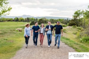 Littleton family photographer foothills Colorado photography walking teen teens laughing fun real moments moment mountain view Lakewood Heritage Center Belmar park summer sunset golden hour