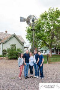 Littleton family photographer Lakewood Heritage Center Colorado photography farm old buildings summer teens teen boy girl windmill foothills