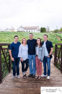Littleton family photographer Lakewood Heritage Center Colorado photography bridge old buildings teen teens high school senior boy summer sunset