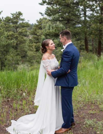 Littleton wedding photographer bride and groom Colorado mountains photography mountain views view Chief Hosa Lodge foothills summer marriage married husband and wife dress white in love