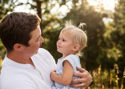 Littleton family photographer father daughter love Colorado photography golden light natural sunset little baby daddy's girl