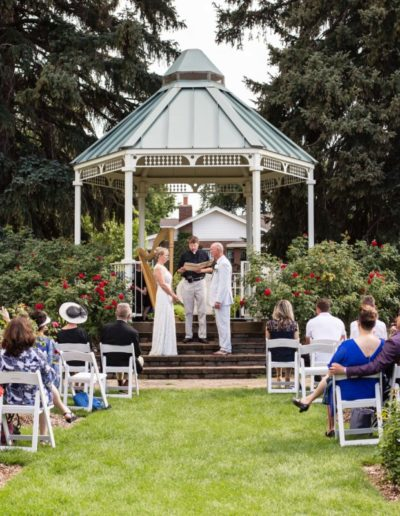 Littleton wedding photographer Colorado photography War Memorial Rose Garden gazebo summer weddings harp player roses outdoor ceremony love intimate rain and sun bride groom natural light husband wife married marriage