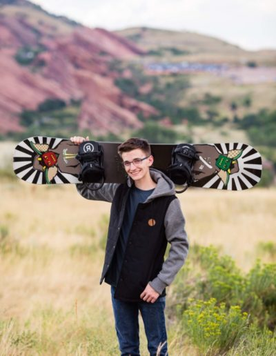 Littleton high school senior portrait photographer Colorado photography senior boy snowboard red rocks rock formations hoodie graduating
