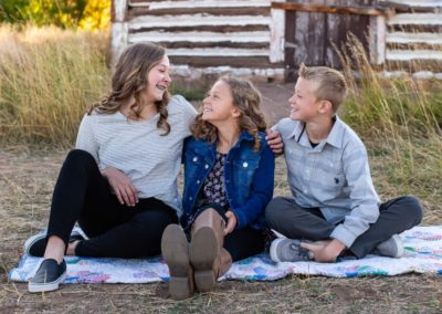 Littleton family photographer in Colorado kid kids children siblings big sister little brother sisters brothers love bond old barn Hildebrand Ranch park fall