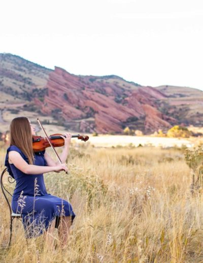 Littleton high school senior photographer Broomfield schools violin red rocks formations Red Rocks Morrison Colorado field portrait session class of 2020