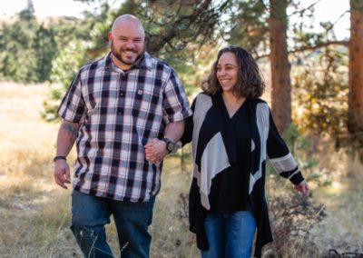 Littleton family photographer in Colorado couple in love walking married marriage fall leaves foothills Mt. Falcon park husband and wife