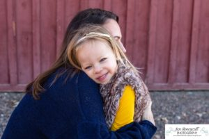 Littleton family photographer in Colorado at the Lakewood Heritage Center with kids children big brother little sister old barns joy Christmas snuggles cold fall winter
