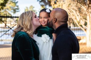 Littleton family photographer in Colorado at the Highlands Ranch Mansion foothills winter light sunset golden hour daughter mother father Santa hats stone building kisses little girl
