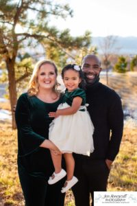 Littleton family photographer in Colorado at the Highlands Ranch Mansion foothills winter light sunset golden hour daughter mother father Santa hats stone building kisses