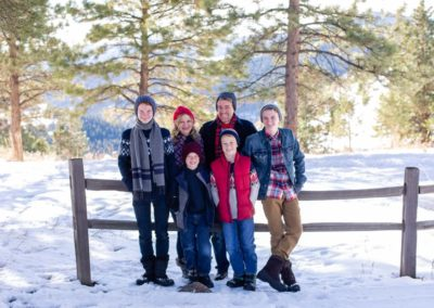 Littleton family teen photographer in Colorado snow mountains view winter wonderland hats boys brothers Mt. Falcon foothills fresh powder photography