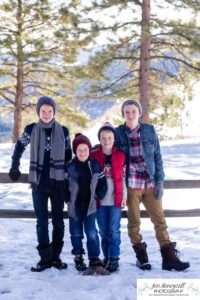Littleton family photographer in Colorado winter snow big boys teen tween kids brothers Mt. Falcon cute hats pine trees mountain views snowball fight Christmas trail