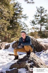 Littleton family photographer in Colorado winter snow big boys teen tween kids brothers Mt. Falcon cute hats pine trees mountain views snowball fight Christmas boy