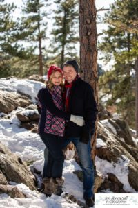 Littleton family photographer in Colorado winter snow big boys teen tween kids brothers Mt. Falcon cute hats pine trees mountain views snowball fight Christmas couple in love marriage married