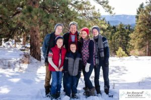 Littleton family photographer in Colorado winter snow big boys teen tween kids brothers Mt. Falcon cute hats pine trees mountain views snowball fight Christmas