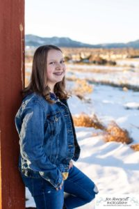 Littleton family photographer in Colorado Ken Caryl valley area three kids children big sister little brother siblings bond love foothills view snow winter natural light sun flare at sunset boy girls teen tween