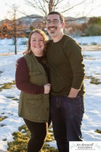 Littleton family photographer in Colorado Ken Caryl valley area three kids children big sister little brother siblings bond love foothills view snow winter natural light sun flare at sunset boy girls married marriage parenthood